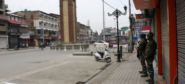 Srinagar: Security beefed up as authorities imposed restrictions in parts of Srinagar city to prevent separatist called protests in connection with the Martyrs Day, on July 13, 2019. July 13 is observed as Martyrs Day in Jammu and Kashmir to remember those killed in the firing outside the Srinagar Central Jail by forces of the Dogra Maharaja in 1931. Shops, public transport and other businesses remained closed in Srinagar and many other towns in the Kashmir Valley. (Photo: IANS)