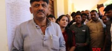 Kanakapura (Karnataka):Karnataka Minister and Congress leader D. K. Shivakumar waits for his turn to cast vote for the second phase of 2019 Lok Sabha elections, at a polling station in Karnataka's Kanakapura, on April 18, 2019. (Photo: IANS)