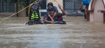 KATHMANDU, July 12, 2019 (Xinhua) -- Nepalese army personnel rescue local people after a heavy rainfall in Kathmandu, Nepal, July 12, 2019. Nepal was hit by heavy rainfall that caused floods and landslides in many places. (Xinhua/Sulav Shrestha/IANS)