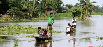 Hajo: People move to higher placees in flood hit Hajo, Assam on July 16, 2019. (Photo: IANS)
