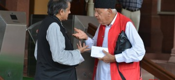 New Delhi: National Conference MP Farooq Abdullah in a conversation with Congress MP Shashi Tharoor at Parliament in New Delhi on July 29, 2019. (Photo: IANS)