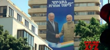 A view of the ten-storey high posters of Indian Prime Minister Narendra Modi with Israeli Prime Minister Benjamin Netanyahu that have been hung from the headquarters of the Likud party headquarters in Tel Aviv as part of its campaign for the September 17 snap polls.