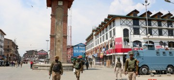 Srinagar: Security personnel enforce restrictions imposed by authorities in Srinagar's  Lal Chowk and adjacent areas to prevent the JKLF called funeral prayers in absentia of Amanullah Khan who died in Pakistan on April 27, 2016. (Photo: IANS)