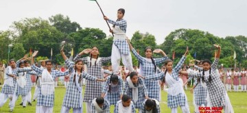 Kupwara: School students participate in full dress rehearsals ahead of 73rd Independence Day celebrations, in Jammu and Kashmir's Kupwara on Aug 13, 2019. Keeping in tune with the government's plan to hold Independence Day functions in every district of Jammu and Kashmir, a full dress rehearsal of the flag hoisting ceremony was held in the District Police Lines in Kupwara. (Photo: IANS/MHA)