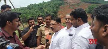 Kavalapara: Kerala Higher Education Minister K.T. Jaleel leads an all-party meeting to Kavalapara on Aug 15, 2019. The misery continues in the village as men and machines work overtime to recover 26 bodies lying deep in the huge pile of mud which till last Thursday was a hillock. In one of the worst ever landslides an area of more than 75 acres, which was full of rubber trees of multiple homesteads, is now nothing but a muddy place. (Photo: IANS)