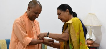 Lucknow: Uttar Pradesh Governor Anandiben Patel ties 'rakhi' on the wrist of Chief Minister Yogi Adityanath, during Raksha Bandhan celebrations in Lucknow on Aug 15, 2019. (Photo: IANS)
