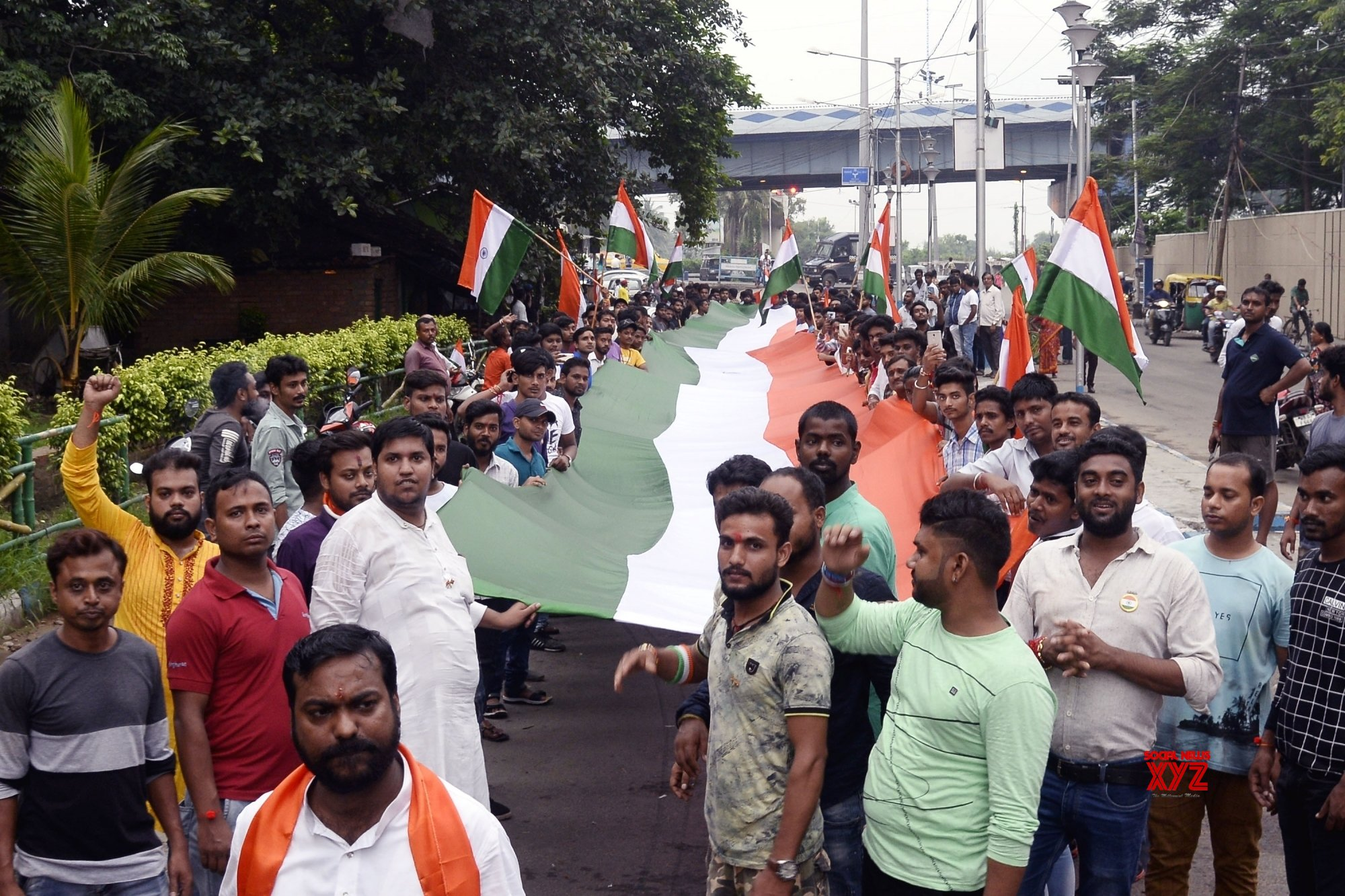 Kolkata: People carry 90 feet long Tricolour during rally on 73rd Independence Day #Gallery