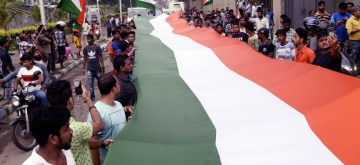 Kolkata: People carry 90 feet long Tricolour as they participate in a rally organised on 73rd Independence Day, in Kolkata on August 15, 2019.  (Photo: IANS)