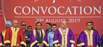 Ahmedabad: Union Home Minister Amit Shah with Gujarat Chief Minister Vijay Rupani, Reliance Industries Chairman Mukesh Ambani and Pandit Deendayal Petroleum University (PDPU) Standing Council Chairman D. Rajagopalan at the 7th Convocation ceremony of PDPU, in Ahmedabad on Aug 29, 2019. (Photo: IANS)