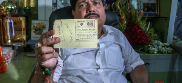 """Bhatpara: BJP MP from Barackpore Arjun Singh who had on Sunday announced that he would send 10 lakh postcards to West Bengal Chief Minister Mamata Banerjee with """"Jai Shri Ram"""" written on them, shows one such postcard with """"Jai Shri Ram"""" written by him, in West Bengal's Bhatpara, on June 3, 2019. (Photo: Indrajit Roy/IANS)"""