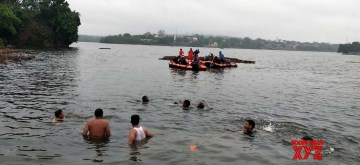 Bhopal: Search and rescue operations underway after a boat capsized during the Ganapati immersion in Bhopal on Sep 13, 2019. Eleven persons drowned in the incident. According to the police, there were 19 people on the boat. Five people were rescued and three people were missing. SDRF teams, divers and police teams are continuing the search through heavy rains. (Photo: IANS)