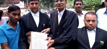 Patna: Advocates show papers after filing a plea challenging the Motor Vehicles Act 2019 in Patna High Court, on Sep 13, 2019. (Photo: IANS)