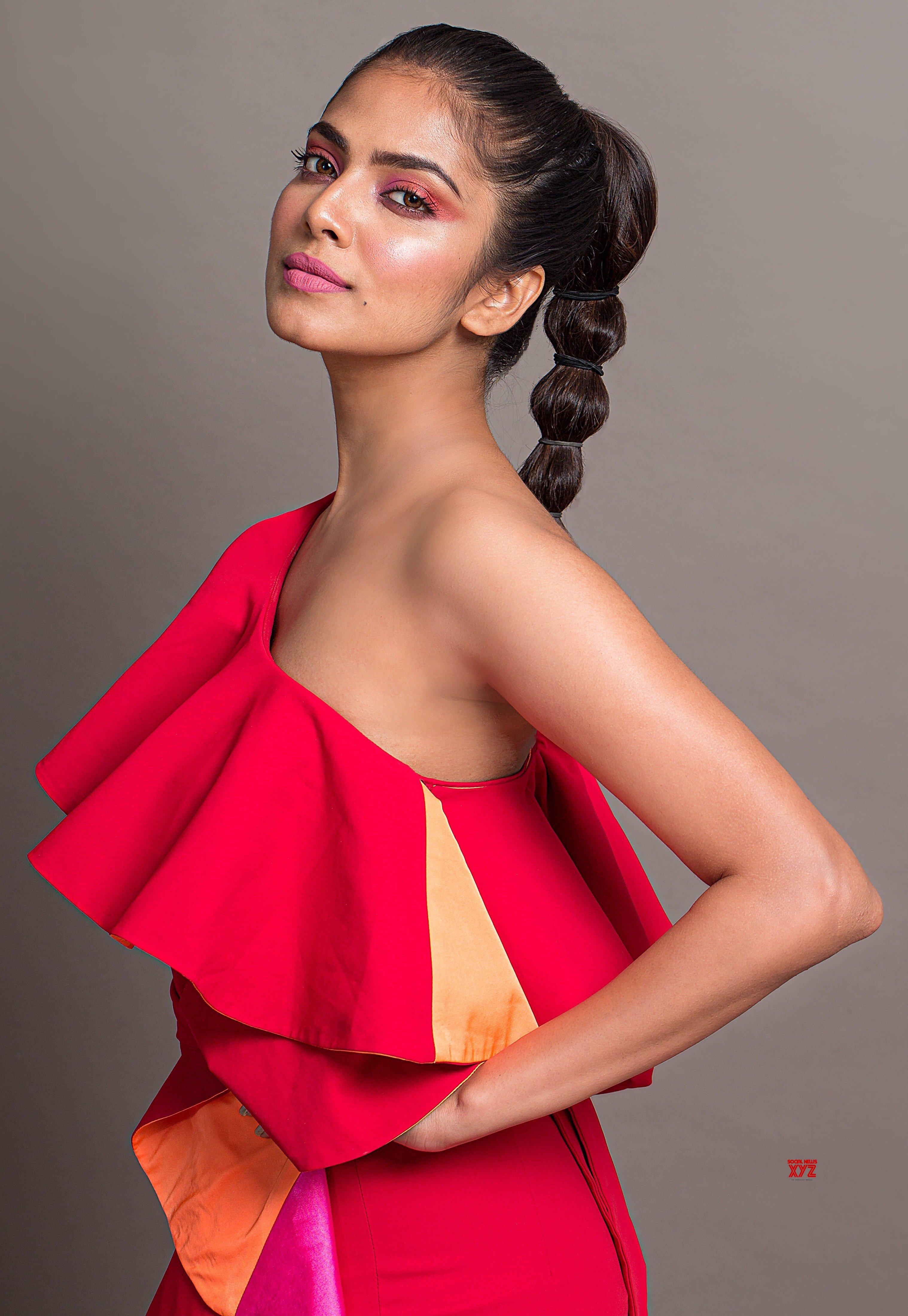 Actress Malavika Mohanan Looks Red Hot In Her Latest HD Stills