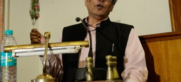 """Kolkata: Chairman of the Economic advisory Council to the Prime Minister of India, Prof Bibek Debroy addresses at a special session on """"New India budget 2019 and the Economic Vision of Modi Government 2.0"""", in Kolkata on July 19, 2019. (Photo: IANS)"""