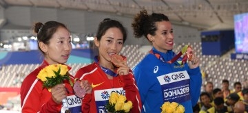 DOHA, Sept. 29, 2019 (Xinhua) -- Gold medalist Liang Rui (C) of China, silver medalist Li Maocuo (L) of China and bronze medalist Eleonora Anna Giorgi of Italy pose for pictures at the awarding ceremony of women's 50km race walk during the 2019 IAAF World Athletics Championships in Doha, Qatar, on Sept. 29, 2019. (Xinhua/Xu Suhui/IANS)