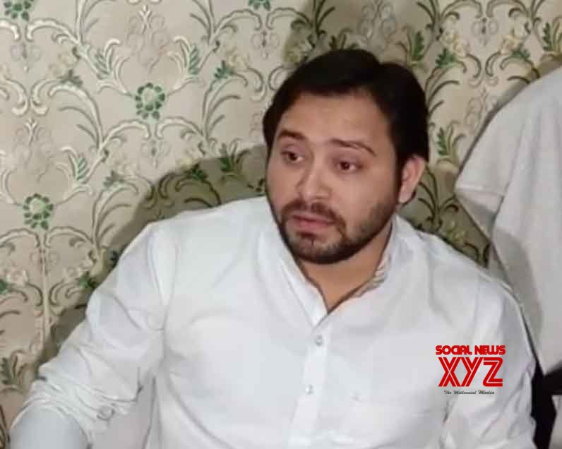 Patna: Tejashwi Yadav talks to the media #Gallery