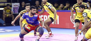 Greater Noida: Players in action during Pro Kabaddi Season 7 match between UP Yoddha and Telugu Titans at Shaheed Vijay Singh Pathik Sports Complex, Greater Noida on Oct 9, 2019. (Photo: IANS)