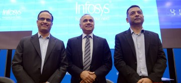 Bengaluru: Infosys COO U B Pravin Rao, CEO Salil Parekh and CFO Nilanjan Roy during a press conference to announce the company's second quarter (Q2) results for the fiscal year 2019-20, in Bengaluru on Oct 11, 2019. (Photo: IANS)