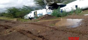 NAIROBI, Oct. 11, 2019 (Xinhua) -- Photo taken on Oct. 11, 2019 shows an aircraft of Silverstone Air, a Kenyan domestic airline, after it skidded off the runway in Nairobi, capital of Kenya. A plane veered off the runway while departing from the Wilson Airport in Kenyan capital Nairobi early Friday, injuring at least two people. The Fokker 50, 5Y IZO operated by Silverstone Air, a Kenya's domestic airline, which was destined to the tourist resort town of Lamu via Mombasa city, skidded off the runway and crashed outside the airport on take-off. (Xinhua/IANS)
