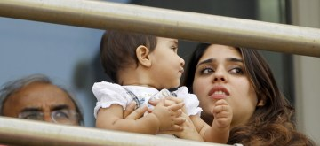 Pune: Cricketer Rohit Sharma's wife Ritika Sajdeh and their daughter Samaira Sharma witness the second Test match between India and South Africa on Day 3, at Maharashtra Cricket Association Stadium in Pune, on Oct 12, 2019. (Photo: Surjeet Yadav /IANS)