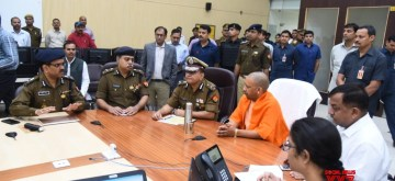 Lucknow: Uttar Pradesh Chief Minister Yogi Adityanath reviews security situation across the state ahead of verdict on Ram Mandir title dispute in Lucknow on Nov 9, 2019. (Photo: IANS)