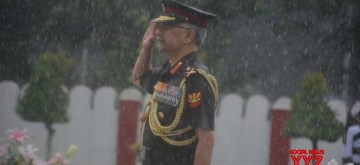 Kolkata: Eastern Army Commander Lt Gen Manoj Mukund Naravane pays tributes to the martyrs during rains, on the 20th Anniversary of Kargil Vijay Diwas, in Kolkata on July 26, 2019. (Photo: IANS)