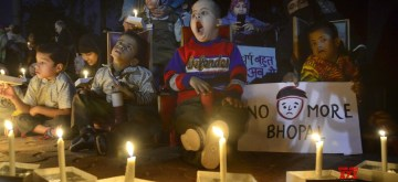 Bhopal: Children participate in a candle light vigil organised to pay tributes to the victims on 34th anniversary of Bhopal Gas Tragedy in Bhopal, on Dec 1, 2018. (Photo: IANS)