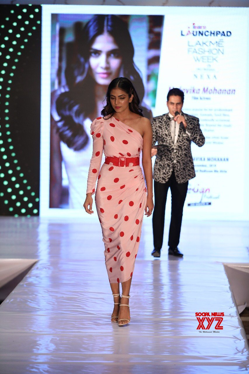Actress Malavika Mohan Glam Stills From INIFD Launch X Lakme Fashion Week Event In Bangalore