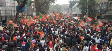 Kolkata: BJP workers participate in a rally in support of the Citizenship Amendment Act (CAA) 2019 and the National Register of Citizens (NRC), in Kolkata on Dec 23, 2019. (Photo: Kuntal Chakrabarty/IANS)