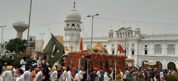 Attari: Sikh devotees participate in International Nagar Kirtan organised from Gurdwara Nankana Sahib in Punjab's Attari as part of the 550th birth anniversary celebrations of Guru Nanak Dev, on Aug 1, 2019. Hundreds of Sikh pilgrims on Tuesday entered Pakistan through Attrai-Wagah border on way to Nankana Sahib in Punjab province of the neighbouring country to celebrate Sikhism founder's 550th birth anniversary. (Photo: IANS)