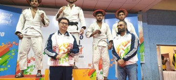 Guwahati: Union Sports Minister Kiren Rijiju and Bollywood actor Suniel Shetty with Judo winners at the medal presentation ceremony during Khelo India Youth Games 2020, in Guwahati on Jan 14, 2020. Rijiju and Shetty have called for a clean and drug-free sports culture and urged the Khelo India athletes to refrain from any banned substances here on Tuesday. (Photo: IANS)
