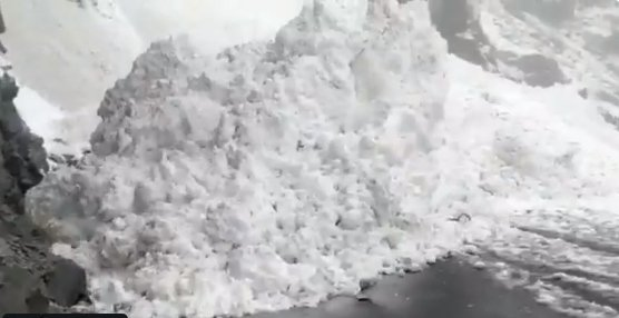 Glacier wall breaks and slides on to highway