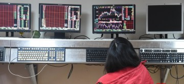 CHANGCHUN, Feb. 25, 2016 (Xinhua) -- An investor looks through stock information at a trading hall in a securities firm in Changchun, capital of northeast China's Jilin Province, Feb. 25, 2016. Chinese stock market closed down more than six-percent on Thursday, with the benchmark Shanghai Composite Index plunged 6.41 percent, to 2,741.25 points. (Xinhua/Zhang Nan/IANS)