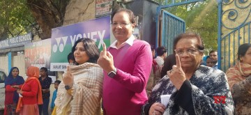 New Delhi: SpiceJet Chairman and MD and Boxing Federation of India (BF) President Ajay Singh along with his family members, shows his inked finger after casting his vote for the Delhi Assembly elections 2020, on Feb 8, 2020. (Photo: IANS)