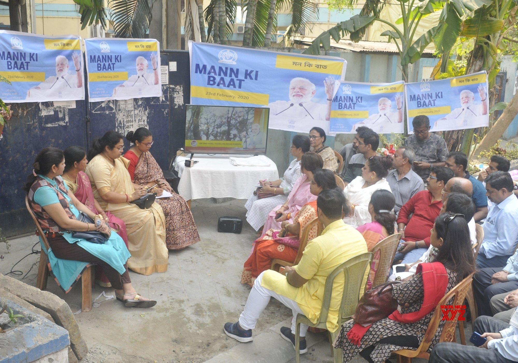 Kolkata: People watch PM Modi's 'Mann Ki Baat' broadcast #Gallery