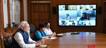 New Delhi: Prime Minister Narendra Modi  interacts with key stakeholders from Electronic Media through video conferencing to discuss the emerging challenges in light of the COVID-19 pandemic, in New Delhi on March 23, 2020. (Photo: IANS/PIB)