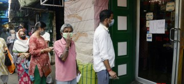 Kolkata: people queue up outside a medical store during a complete lockdown for 21 days announced by Prime Minister Narendra Modi to prevent further spreading of the COVID 19 pandemic in India; in Kolkata on March 25, 2020. (Photo: Kuntal Chakrabarty/IANS)