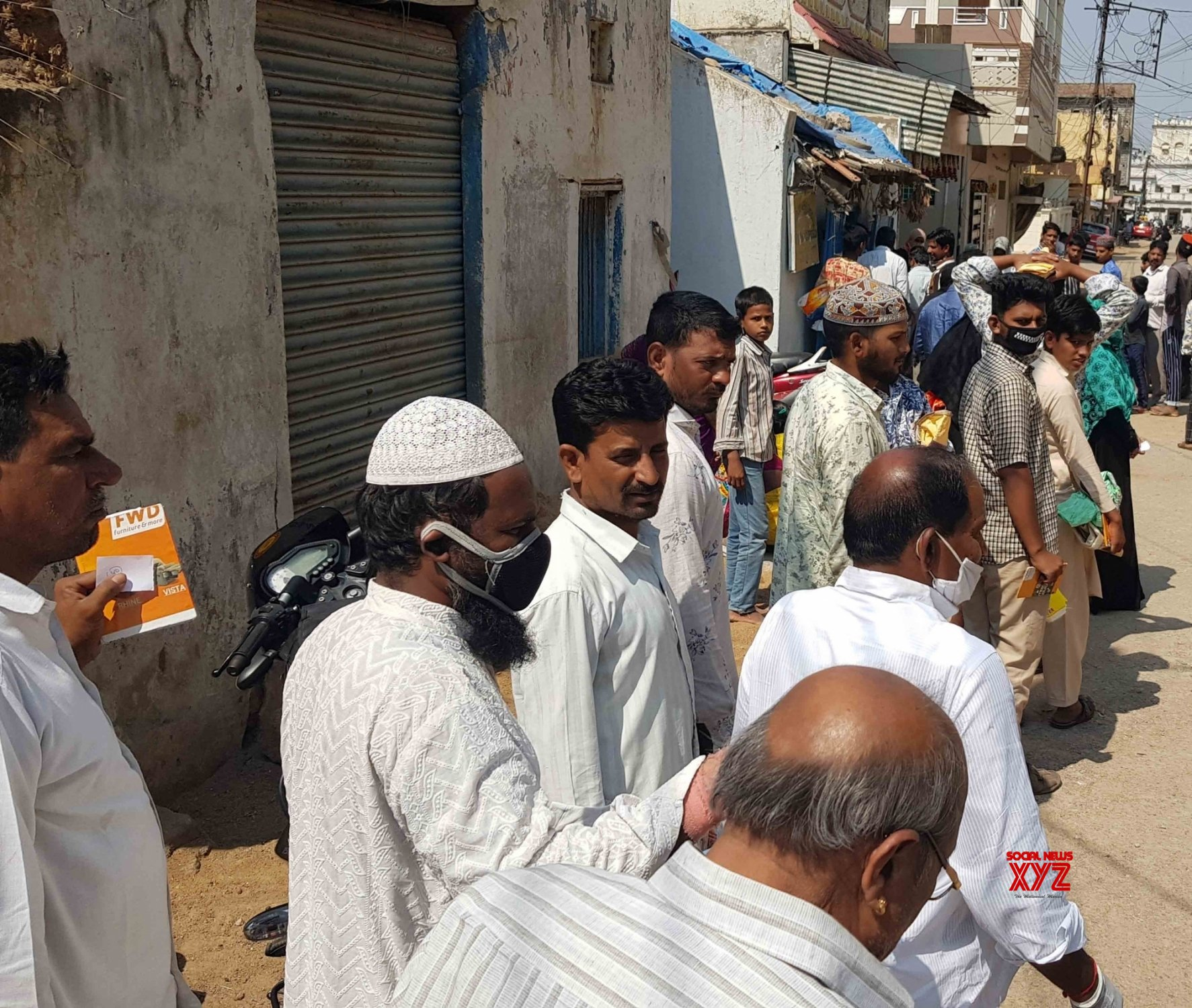 Hyderabad: People queue up outside ration shops amid lockdown #Gallery
