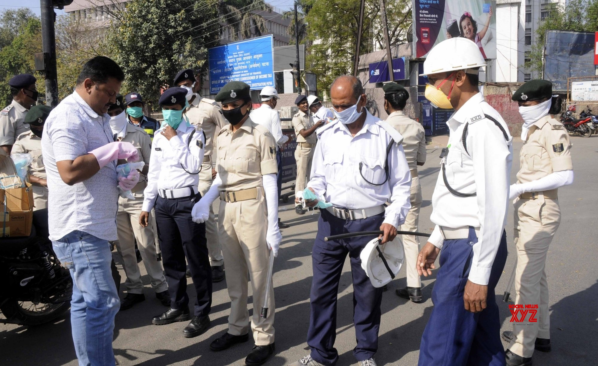 Patna: Hand gloves, sanitisers and masks distributed among police personnel on Day 2 of 21 - day nationwide lockdown #Gallery