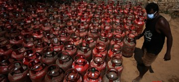 Chennai: A worker busy arranging LPG Gas cylinders at a godown on Day 2 of the 21-day nationwide lockdown imposed by the Narendra Modi government over the coronavirus pandemic; in Chennai on March 26, 2020. (Photo: IANS)