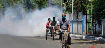 Kolkata: Bidhannagar Municipal Corporation workers spraying chemical fumigation during the nationwide during a 21-day lockdown announced by Prime Minister Narendra Modi as a precautionary measure to contain the spread of COVID-19, in Kolkata on March 27, 2020. (Photo: Kuntal Chakrabarty/IANS)