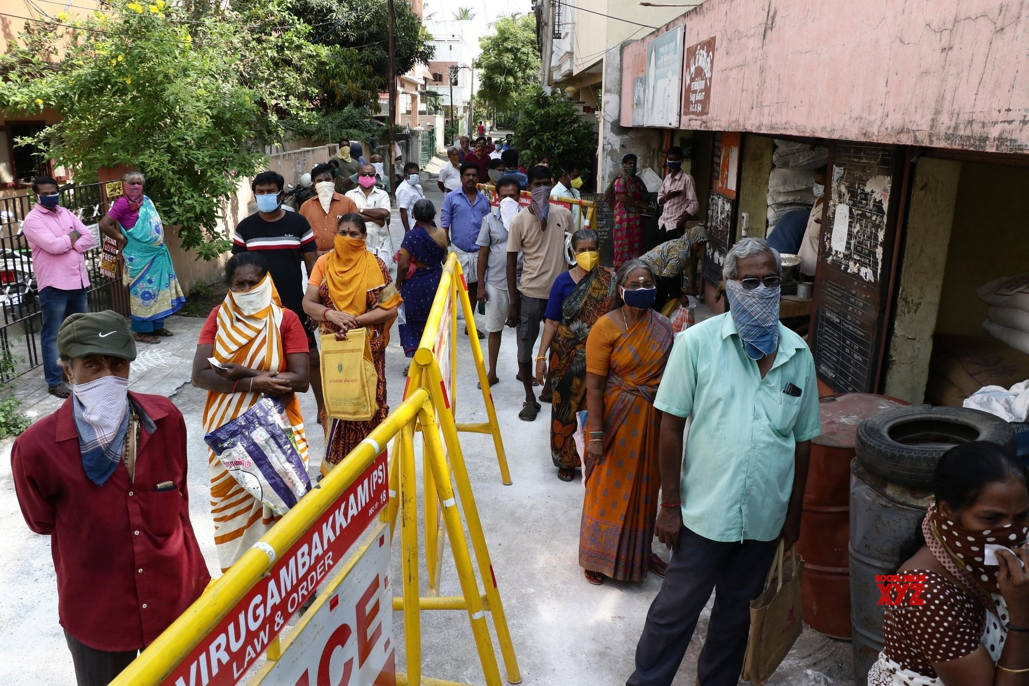 Chennai: People queue up outside ration shop during lockdown ...