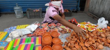 Guwahati: Earthen lamps and candles being sold at a street-side stall during the 21-day nationwide lockdown (that entered the 12th day) imposed as a precautionary measure to contain the spread of coronavirus, in Guwahati on Apr 5, 2020. Prime Minister Naredra Modi had on April 3 asked the countrymen to light lamps or candles for nine minutes at 9 p.m. on Sunday to challenge the darkness caused by coronavirus. (Photo: IANS)