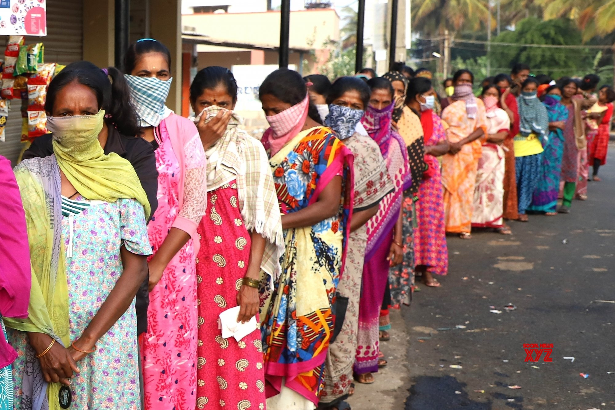 Bengaluru: People violate social distancing orders as they rush to collect free milk during lockdown #Gallery