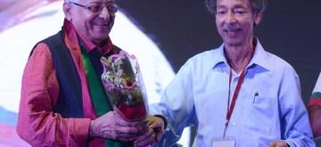 New Delhi: Mohun Bagan Secretary Anjan Mitra felicitates veteran footballer Chuni Goswami during Mohun Bagan Day celebrations in Kolkata on July 29, 2018. (Photo: IANS)