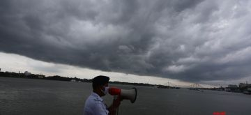 Kolkata: A river police personnel makes announcements and issue warnings in the wake of cyclonic storm Amphan in Kolkata on May 19, 2020. (Photo: Kuntal Chakrabarty/IANS)