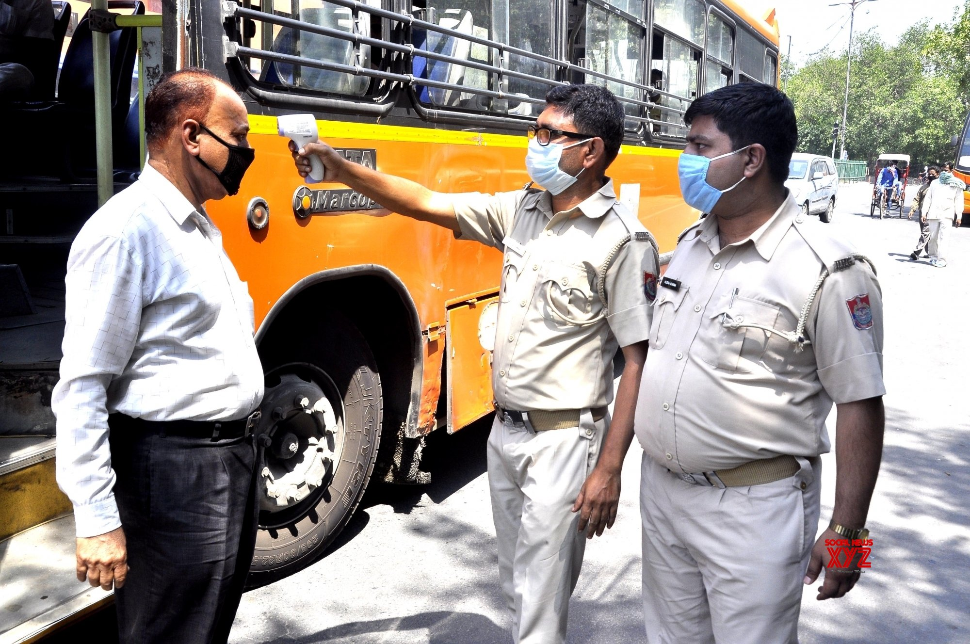 New Delhi: Passengers deboarding DTC buses screened for COVID - 19 #Gallery