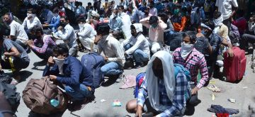 Amritsar: Migrant workers from Uttar Pradesh gather for medical screening before boarding a train to Sultanpur to return to their home state during the fourth phase of the nationwde lockdown imposed to mitigate the spread of coronavirus, in Amritsar on May 20, 2020. (Photo: IANS)