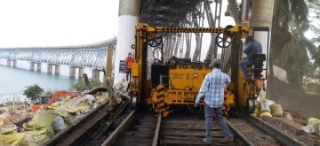 East Godavari: The rail-cum-road bridge over the Godavari river in Andhra Pradesh's East Godavari district undergoes maintenance work during the fourth phase of the nationwide lockdown imposed to mitigate the spread of coronavirus, on May 21, 2020. (Photo: IANS)