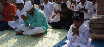 Patna: People offer Eid prayers on the occasion of Eid-Ul-Fitr at the terris of their residence in Patna during the fourth phase of the nationwide lockdown imposed to mitigate the spread of coronavirus, on May 25, 2020. (Photo: IANS)